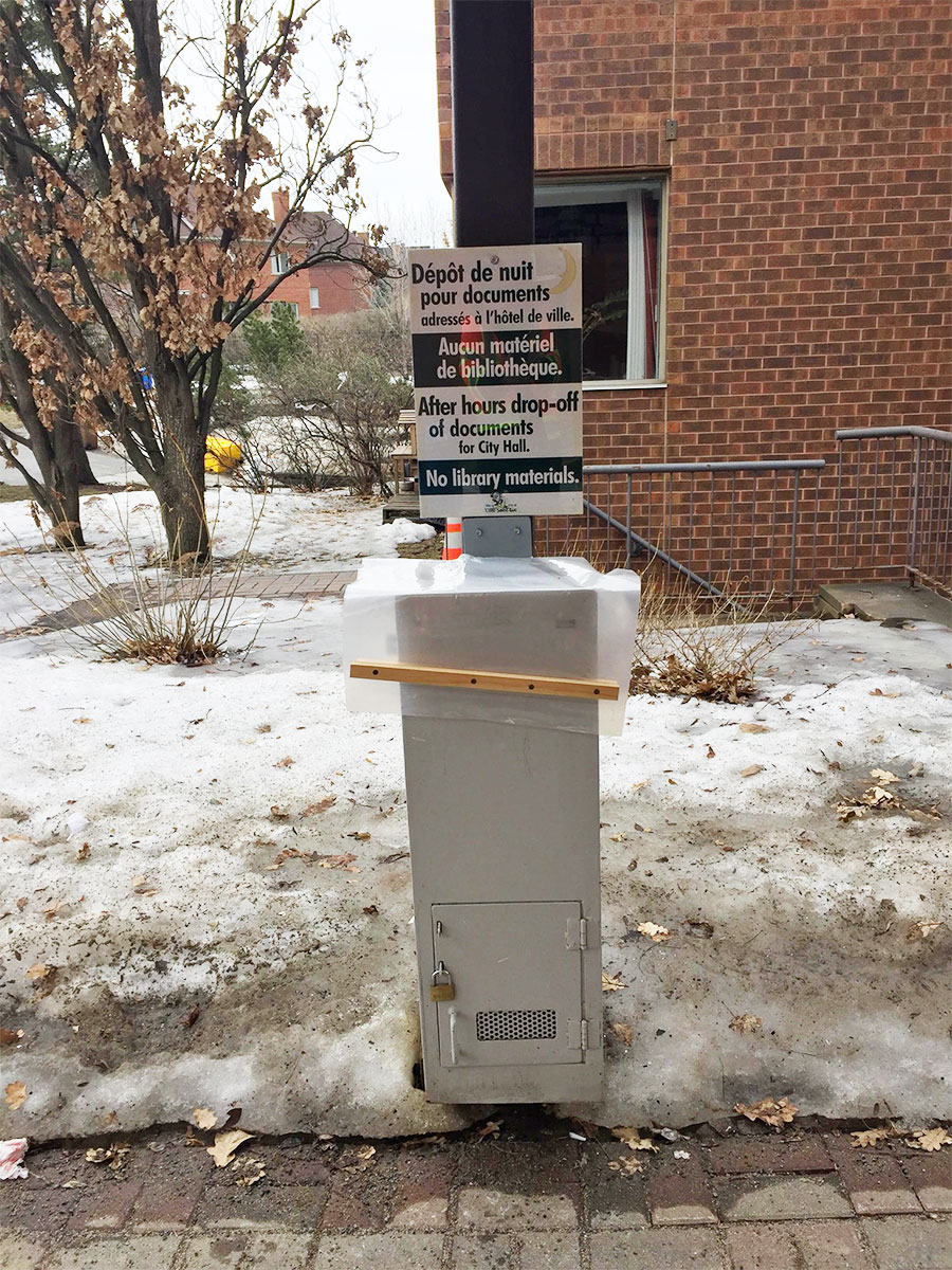 Metal drop-off box in front of City Hall